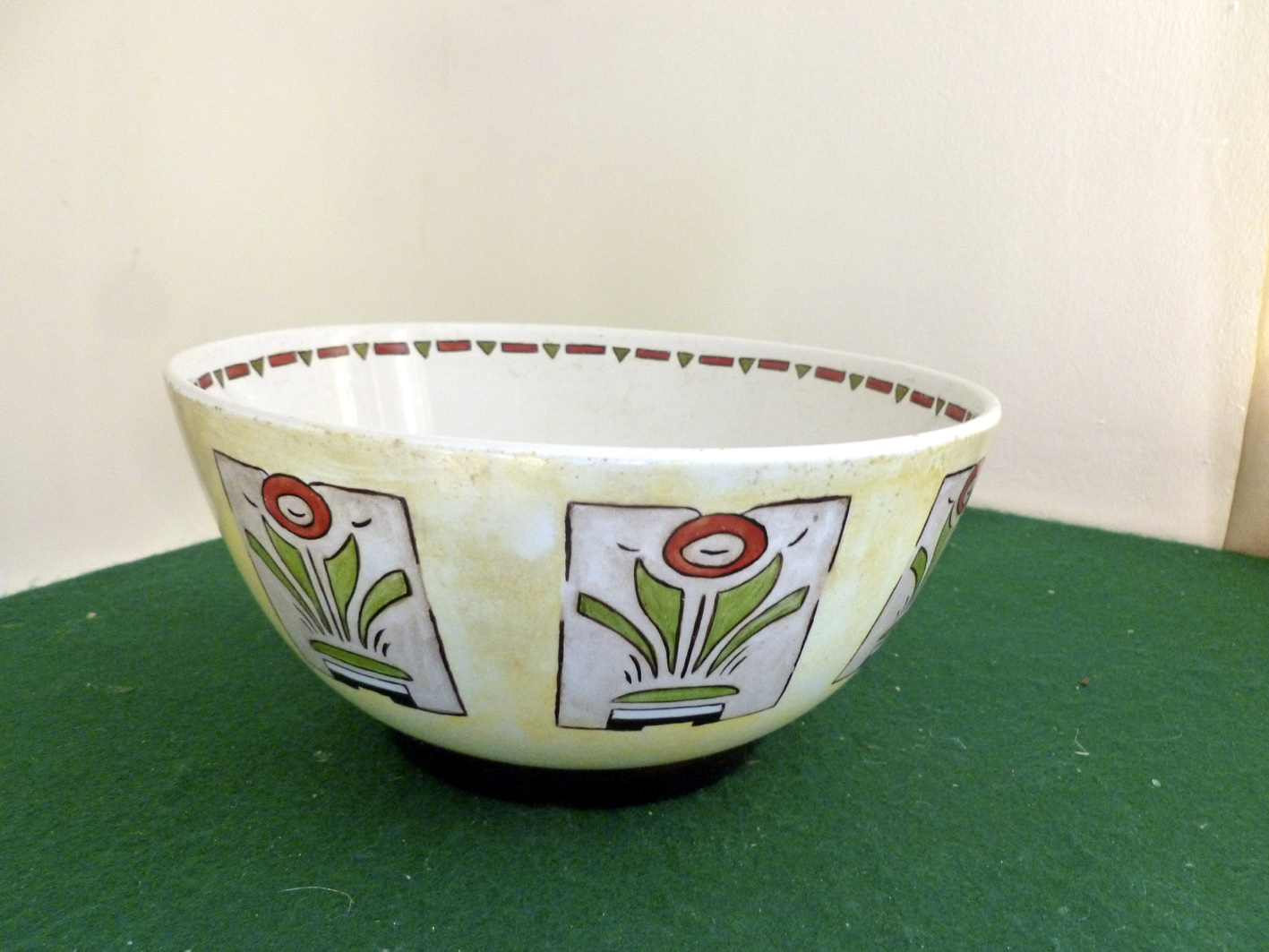 Excellent example of Art Deco Style in useful fruit bowl, creamy yellow background, black foot and decorated with geometric design of stylised flowers. Very trendy and in perfect